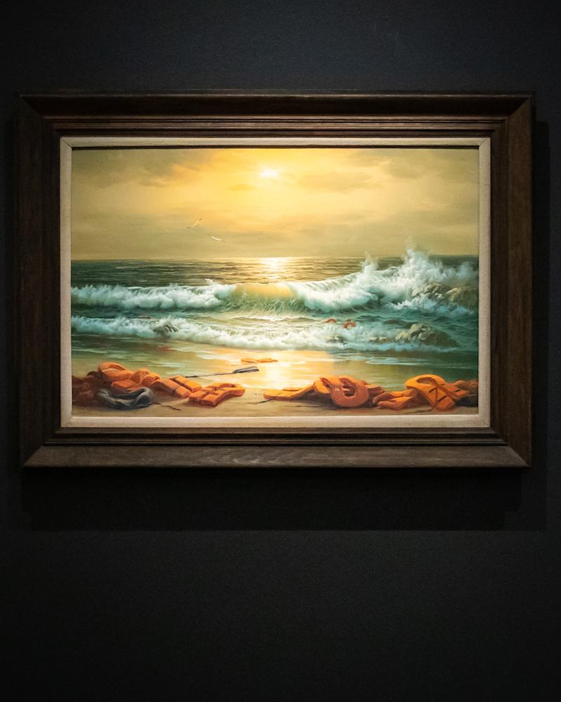 One of a triptych, Mediterranean Sea View by Banksy 2017, reworked oil paintings in artists frames in three parts with an estimate of GBP 800k -1.2 million during a press preview at Sotheby's in London ahead of their 'From Rembrandt to Richter' sale on July 28. (Photo by Aaron Chown/PA Images via Getty Images)
