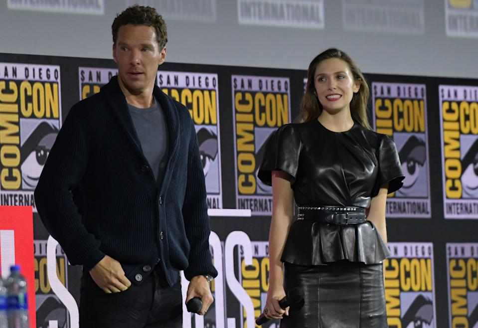 English actor Benedict Cumberbatch and US actress Elizabeth Olsen during the Marvel panel in Hall H of the Convention Center during Comic Con in San Diego, California on July 20, 2019. (Photo by Chris Delmas / AFP)        (Photo credit should read CHRIS DELMAS/AFP/Getty Images)