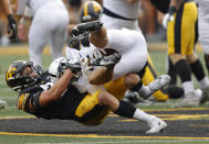 Iowa linebacker Jack Campbell (31) rips down Penn State wide receiver Parker Washington (3) during the first half of an NCAA college football game, Saturday, Oct. 9, 2021, in Iowa City, Iowa. (AP Photo/Matthew Putney)