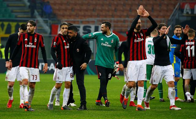Soccer Football - Europa League Round of 32 Second Leg - AC Milan vs PFC Ludogorets Razgrad - San Siro, Milan, Italy - February 22, 2018 AC Milan coach Gennaro Gattuso celebrates with Ricardo Rodriguez as Leonardo Bonucci applauds the fans at the end of the match REUTERS/Tony Gentile