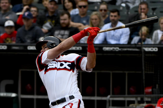 Chicago White Sox's James McCann hits an RBI-single during the first inning of a baseball game against the Los Angeles Angels, Sunday, Sept. 8, 2019, in Chicago. (AP Photo/Matt Marton)