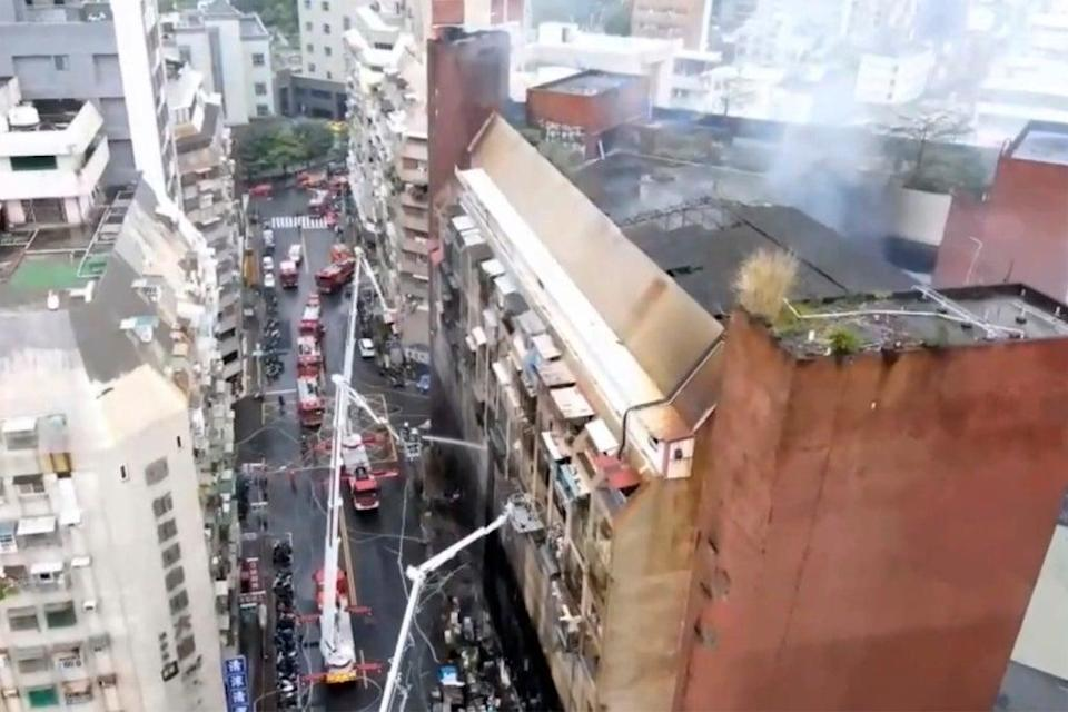 The blaze was brought under control by 7.17am but search and rescue operations to find survivors continue (AP)