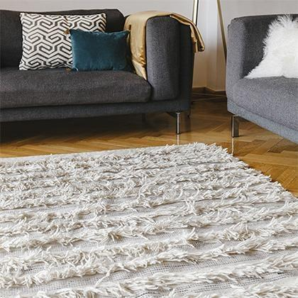 <p>Consider investing in this handmade <span>Fringe Rug</span> ($1,225) which is inspired by African design and will elevate any room.</p>