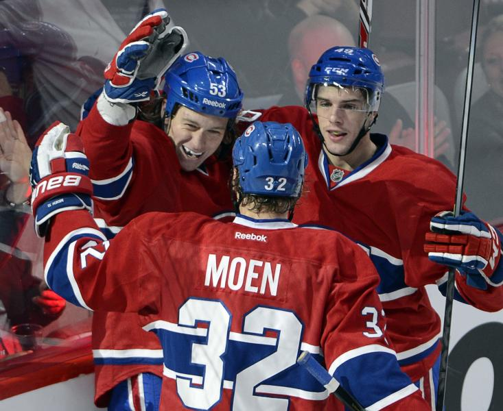 Montreal Canadiens' Ryan White (53) celebrates with teammates Travis Moen and Michael Bournival, right, after scoring against the New Jersey Devils during the third period of an NHL hockey preseason game Monday, Sept. 23, 2013, in Montreal. The Canadiens won 3-2. (AP Photo/The Canadian Press, Ryan Remiorz)
