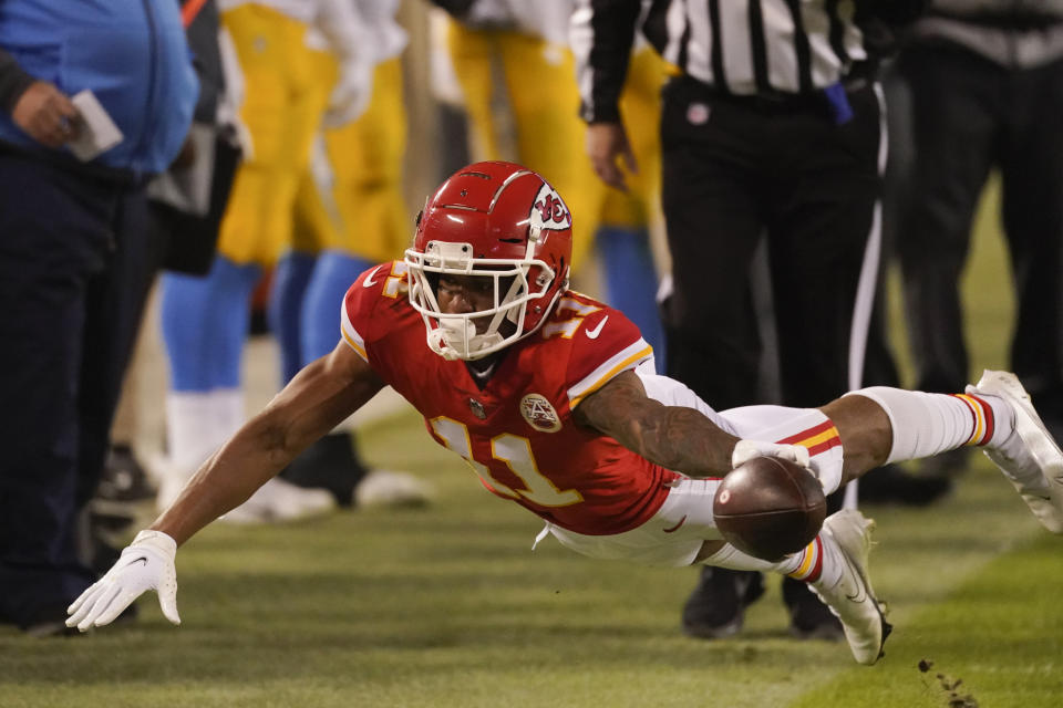 Kansas City Chiefs wide receiver Demarcus Robinson dives for extra yardage during the second half of an NFL football game against the Los Angeles Chargers, Sunday, Jan. 3, 2021, in Kansas City. (AP Photo/Charlie Riedel)