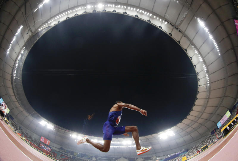 Christian Taylor, of the United States, competes in the men's triple jump final at the World Athletics Championships in Doha, Qatar, Sunday, Sept. 29, 2019. Taylor won the gold medal in the event. (AP Photo/Hassan Ammar)