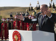 """Turkey's President Recep Tayyip Erdogan speaks addresses during a ceremony in Ahlat, eastern Turkey, Wednesday, Aug. 25, 2021. Turkey has begun to evacuate its troops from Afghanistan after nearly 20 years in the country, the Defense Ministry said Wednesday. Erdogan said Turkey would treat the Taliban's future statements with """"cautious optimism"""". """"The Taliban's actions and steps will determine the shape of the next stage in Afghanistan, not the words of the Taliban,"""" he told a meeting in Ahlat. (Turkish Presidency via AP, Pool)"""