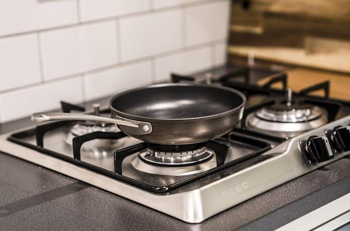 """<p>If you want to <a href=""""https://www.thespruce.com/baking-soda-and-pots-and-pans-1900441"""" rel=""""nofollow noopener"""" target=""""_blank"""" data-ylk=""""slk:get your pots and pans looking like new"""" class=""""link rapid-noclick-resp"""">get your pots and pans looking like new</a>, The Spruce suggests using some baking soda. For porcelain-enameled cast-iron cookware, fill the pot or pan with about one quart of water and bring to a boil. Once boiling, add two tablespoons of baking soda, stir, and let simmer for several minutes. Then dump out the pot and rinse the pan with warm water. </p><p>Non-stick frying pans can also benefit from a mixture of baking soda and water. Simply cover the bottom of the pan with a layer of water and sprinkle baking soda over the water to create a thin paste. Let the pan sit for several hours, then rinse and wash the pan.</p>"""