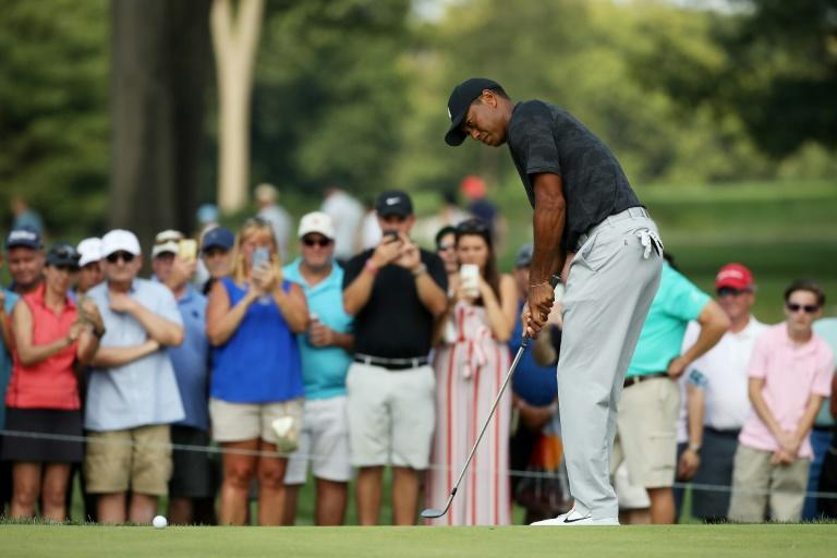 Tiger Woods faced a near hour anxious wait before confirmation his scores of a pair of 71s was good enough to make the cut at the Northern Trust