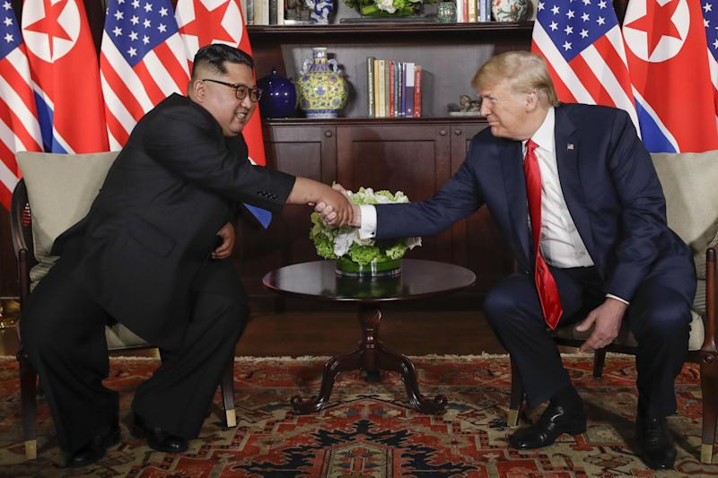Donald Trump shakes hands with North Korea leader Kim Jong-un during their first meeting: AP
