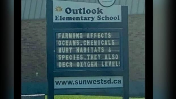 A May 25 sign at Outlook Elementary School in Saskatchewan was taken down after it upset a number of people in the agricultural industry.  (View From The Ranch Porch/Facebook - image credit)