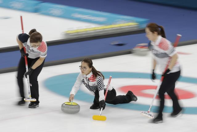 Kim Eun-jung, of South Korea, throws during their women's curling final in the Gangneung Curling Centre at the 2018 Winter Olympics in Gangneung, South Korea, Sunday, Feb. 25, 2018. (AP Photo/Natacha Pisarenko)