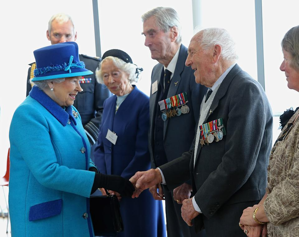 FOLKESTONE, ENGLAND - MARCH 26:  Queen Elizabeth II meets Mrs K Foster (L), Wing Commander Paul Farnes (C) and Squadron Leader Tom Pickering as she visits the National Memorial to the Few ahead of opening a new wing on March 26, 2015 in Folkestone, England.  (Photo by Chris Jackson - WPA Pool/Getty Images)
