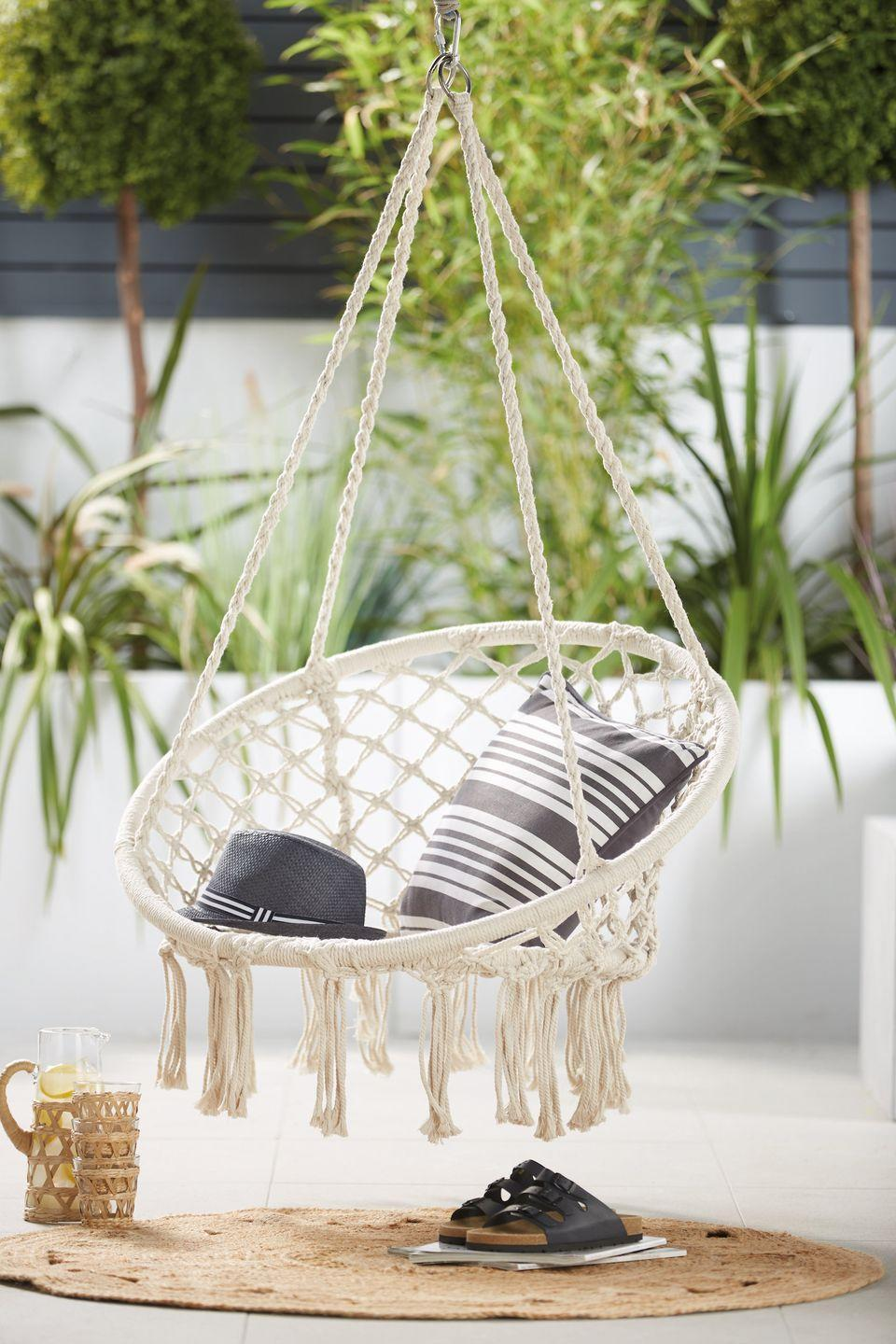 """<p>We're crushing on this stylish hanging rope seat, which shoppers can snap up for just £40.</p><p>'""""Continue the celeb feel and get the Mrs Hinch look for less with our brand-new Hanging Rope Seat (£39.99), perfect for a spot of evening relaxation,"""" the German supermarket says. """"Shoppers can even save over 54% compared to leading retailers including Wayfair.""""</p><p><a class=""""link rapid-noclick-resp"""" href=""""https://www.aldi.co.uk/c/specialbuys/garden-shop"""" rel=""""nofollow noopener"""" target=""""_blank"""" data-ylk=""""slk:SHOP NOW"""">SHOP NOW</a></p>"""
