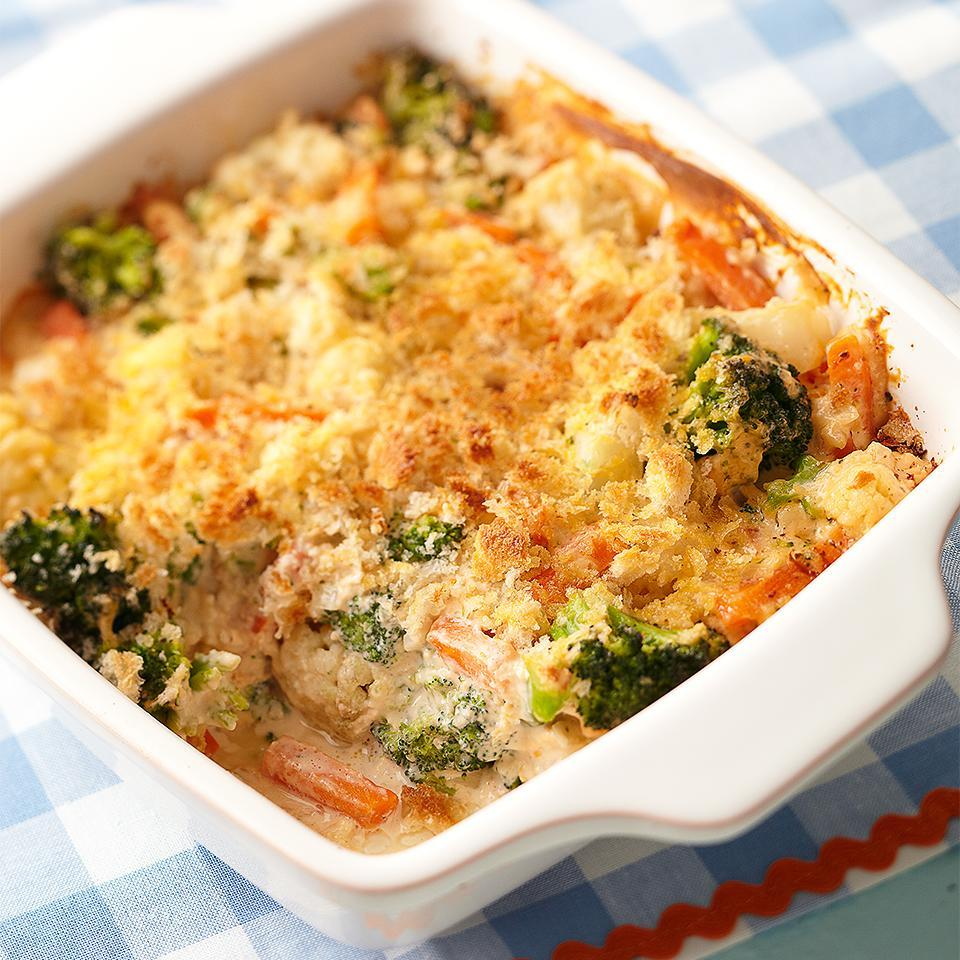 <p>This Cheesy Vegetable Bake casserole has 7 grams of protein and only 4 grams of fat per serving, making it an ideal side dish for any dinner. Using reduced-fat cheeses lowers the fat content of this recipe but does not compromise flavor.</p>
