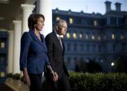 U.S. House Minority Leader Nancy Pelosi (D-CA) (L) and Senate Majority Leader Harry Reid (D-NV) walk from the West Wing of the White House in Washington, October 2, 2013, following a meeting with U.S. President Barack Obama, House Speaker John Boehner (R-OH), and Senate Minority Leader Mitch McConnell (R-KY). Obama met with Republican and Democratic leaders in Congress on Wednesday to try to break a deadlock that has shut down wide swaths of the federal government, but there was no breakthrough. REUTERS/Jason Reed