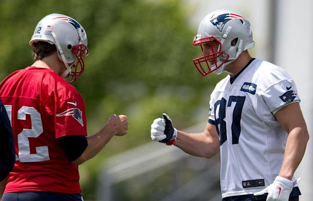 """<a class=""""link rapid-noclick-resp"""" href=""""/nfl/teams/new-england/"""" data-ylk=""""slk:New England Patriots"""">New England Patriots</a> quarterback <a class=""""link rapid-noclick-resp"""" href=""""/nfl/players/5228/"""" data-ylk=""""slk:Tom Brady"""">Tom Brady</a> hopes recently retired <a class=""""link rapid-noclick-resp"""" href=""""/nfl/players/24017/"""" data-ylk=""""slk:Rob Gronkowski"""">Rob Gronkowski</a> catches more touchdowns from him. (AP)"""