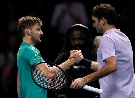 Belgium's David Goffin shakes hands with Switzerland's Roger Federer after winning their semi final match. Reuters/Tony O'Brien