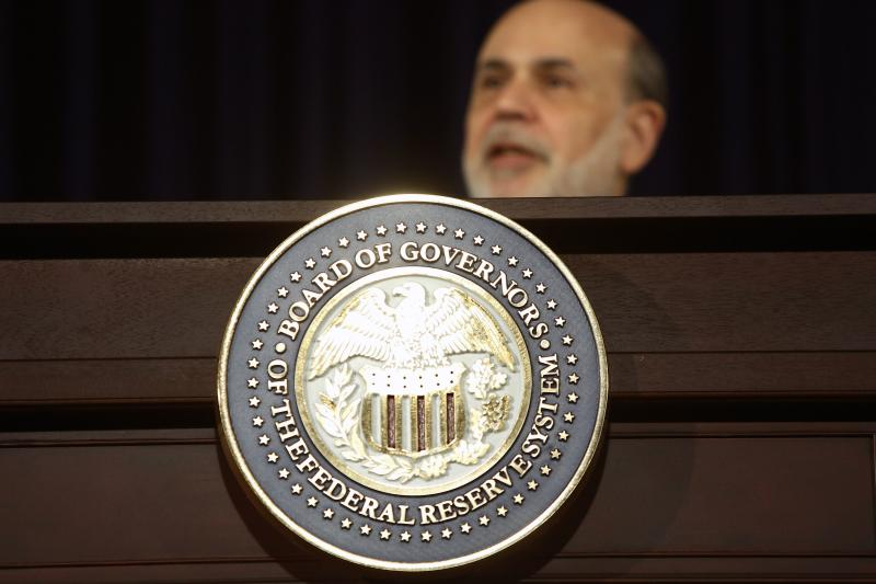 U.S. Federal Reserve Chairman Bernanke responds to reporters during his final planned news conference before his retirement, in Washington