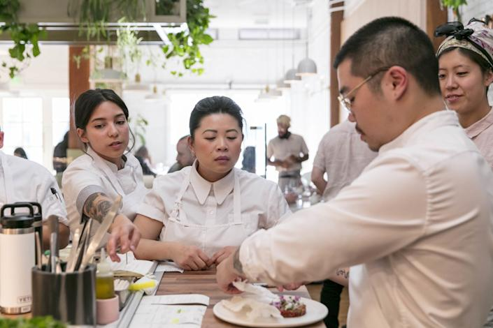 """Mei Lin, center, with her team at Nightshade in April, 2019. <span class=""""copyright"""">(Silvia Razgova / For The Times)</span>"""