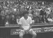 <p>Roumanian Ilie Nastase takes a seat after losing the Wimbledon Men's Singles Final to Stan Smith in 1972.</p>