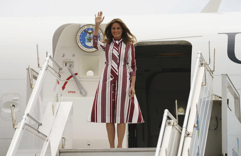 FLOTUS changed into a striped Celine number before landing in Accra, Ghana. (Photo: Carolyn Kaster/AP)
