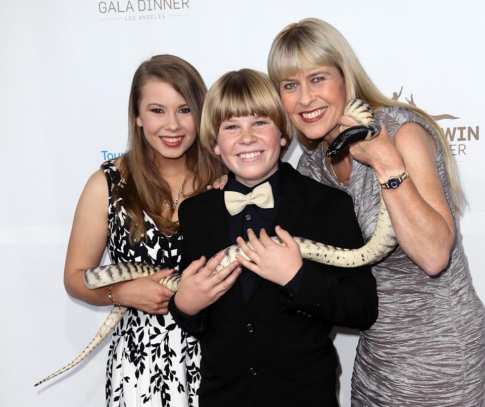 Bob Irwin holds a snake alongside his sister, Bindi Irwin and his mum Terri Irwin at the Steve Irwin Gala Dinner at JW Marriott Los Angeles at L.A. LIVE on May 21, 2016 in Los Angeles, California.