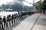 Police security forces form a line to block a road near the U.S. embassy in Yangon, Myanmar Monday, Feb. 22, 2021. Protesters gathered in Myanmar's biggest city Monday despite the ruling junta's thinly veiled threat to use lethal force if people answered a call for a general strike opposing the military takeover three weeks ago.(AP Photo)