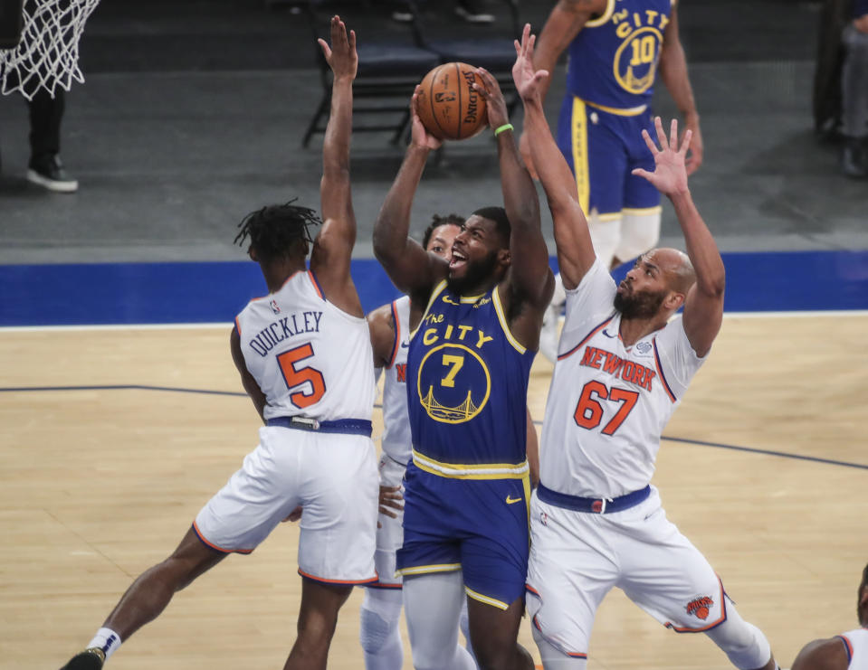 Golden State Warriors forward Eric Paschall (7) is defended by New York Knicks guard Immanuel Quickley (5) and center Taj Gibson (67) during the first half of an NBA basketball game Tuesday, Feb. 23, 2021, in New York. (Wendell Cruz/Pool Photo via AP)