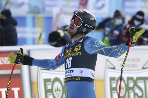 United States' Bryce Bennett reacts after completing an alpine ski men's World Cup downhill in Val Gardena, Italy, Saturday, Dec. 19, 2020. (AP Photo/Alessandro Trovati)