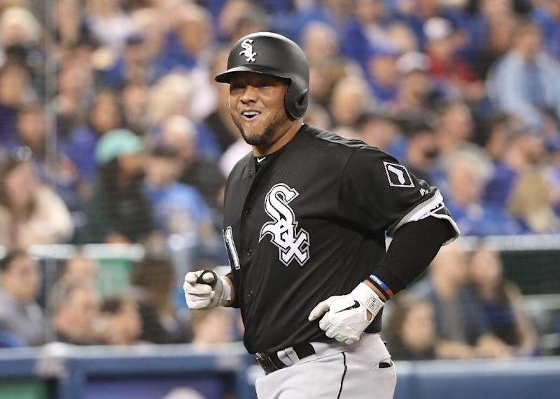 Welington Castillo of the Chicago White Sox laughs as he approaches the dugout after hitting a solo home run in the fourth inning during MLB game action against the Toronto Blue Jays at Rogers Centre on April 2, 2018