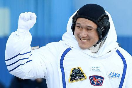 FILE PHOTO: Members of the International Space Station expedition 54/55, Norishige Kanai of the Japan Aerospace Exploration Agency (JAXA) during the send-off ceremony after checking their space suits before the launch of the Soyuz MS-07 spacecraft at the Baikonur cosmodrome, in Kazakhstan, 17 December 2017.  REUTERS/Kirill Kudryavtsev/Pool/File Photo