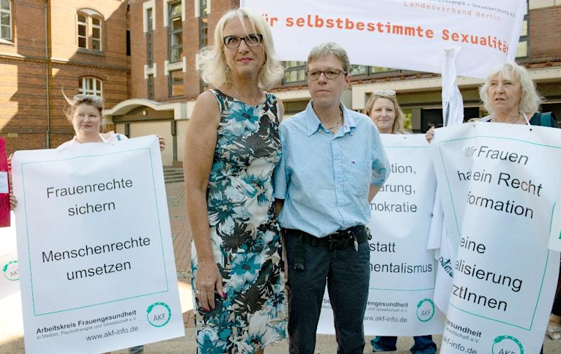 Supporters stand by doctors Bettina Gaber and Verena Weyer outside the Berlin district court as both vow to appeal their fines