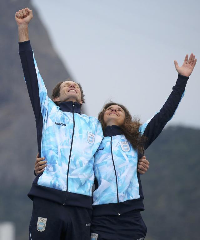 2016 Rio Olympics - Sailing - Victory Ceremony - Mixed Multihull - Nacra 17 - Victory Ceremony - Marina de Gloria - Rio de Janeiro, Brazil - 16/08/2016. Santiago Lange (ARG) of Argentina and Cecilia Carranza (ARG) of Argentina pose with their medals. REUTERS/Benoit Tessier FOR EDITORIAL USE ONLY. NOT FOR SALE FOR MARKETING OR ADVERTISING CAMPAIGNS.