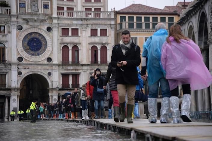 Hotels reported cancelled reservations, some as far ahead as December, following the widespread diffusion of images of Venice underwater (AFP Photo/Filippo MONTEFORTE )