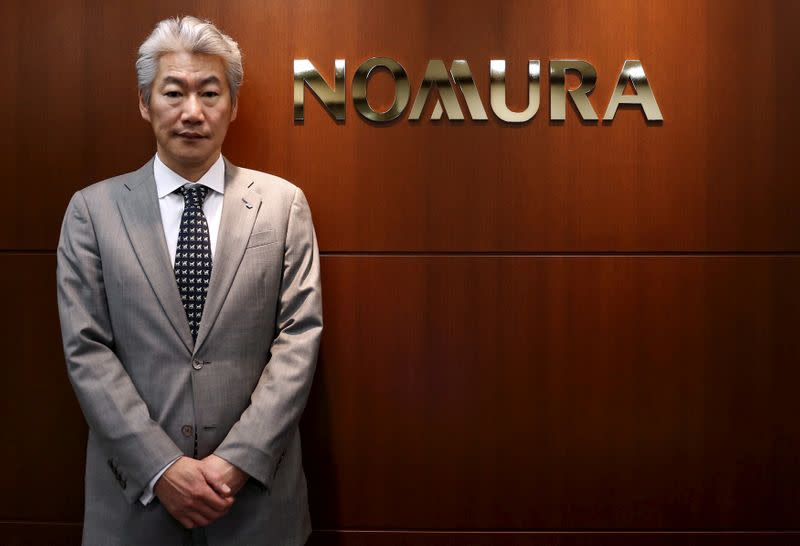 FILE PHOTO: Nomura Holdings' Chief Executive Officer Nagai poses for pictures after an interview with Reuters in Tokyo