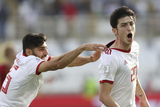 Iran's forward Sardar Azmoun, right, celebrates after scoring his side's second goal during the AFC Asian Cup group D soccer match between Iran and Vietnam at Al Nahyan Stadium in Abu Dhabi, United Arab Emirates, Saturday, Jan. 12, 2019. (AP Photo/Kamran Jebreili)
