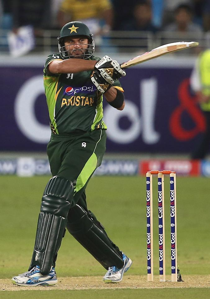 DUBAI, UNITED ARAB EMIRATES - DECEMBER 11:  Shahid Afridi of Pakistan bats during the first Twenty20 International match between Pakistan and Sri Lanka at Dubai Sports City Cricket Stadium on December 11, 2013 in Dubai, United Arab Emirates.  (Photo by Francois Nel/Getty Images)