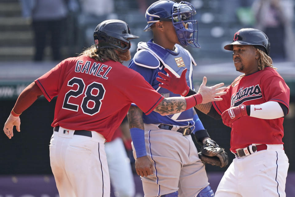 Cleveland Indians' Jose Ramirez, right, is congratulated by Ben Gamel after Ramirez hit a two-run home run in the eighth inning of a baseball game, Wednesday, April 7, 2021, in Cleveland. The Indians won 4-2. (AP Photo/Tony Dejak)