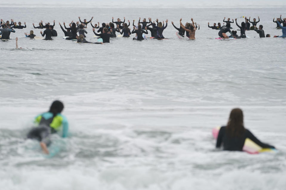 "Surfers participate in a paddle out ceremony at ""The Ink Well,"" a beach historically known as a surfing refuge for African Americans, to honor the life of George Floyd on Friday, June 5, 2020, in Santa Monica, Calif. Floyd, a black man, died after he was restrained in police custody on Memorial Day in Minneapolis. (AP Photo/Ashley Landis)"