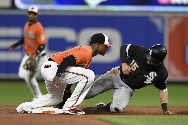 Baltimore Orioles' shortstop Tim Beckham tags out Chicago White Sox Adam Engle on a steal attempt in the third inning of a baseball game, Saturday, Sept. 15, 2018, in Baltimore. (AP Photo/Gail Burton)