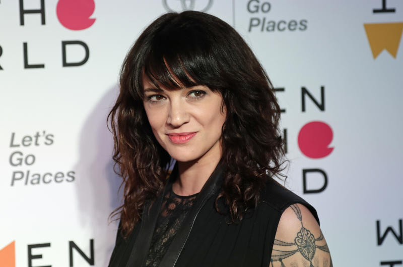 FILE - In this April 12, 2018 file photo, Italian actress and director Asia Argento arrives at the ninth annual Women in the World Summit in New York. Argento, one of the most prominent activists of the #MeToo movement against sexual harassment, recently settled a complaint filed against her by a young actor and musician who said she sexually assaulted him when he was 17, the New York Times reported. (AP Photo/Frank Franklin II, File)
