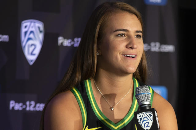 FILE - In this Oct. 7, 2019, file photo, Oregon's Sabrina Ionescu speaks to reporters during the Pac-12 Conference women's NCAA college basketball media day in San Francisco. Ionescu earned a spot on The Associated Press women's basketball All-America team Thursday, March 19, 2020, as a unanimous choice from the national media panel that votes on the Top 25 each week. (AP Photo/D. Ross Cameron, File)