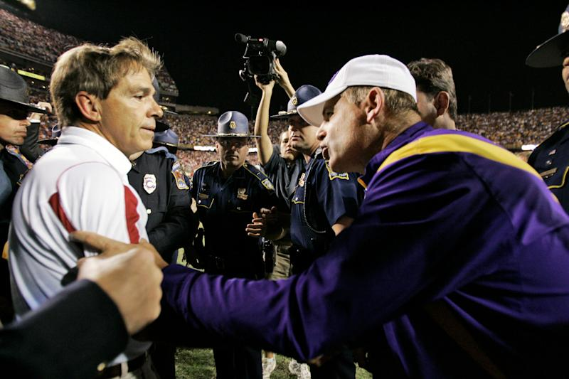 "In this Nov. 8, 2008, photo, Alabama coach Nick Saban, left, and LSU coach Les Miles talk after Alabama defeated LSU 27-21 in an NCAA college football game in Baton Rouge, La. Fifth ranked Alabama has climbed back into the national title race, but staying there won't be easy. The Crimson Tide visits No. 12 LSU on Saturday and is the only team with three ranked opponents left in the regular season. No. 21 Mississippi State and No. 3 Auburn come to Tuscaloosa after that. Coach Nick Saban on Monday Nov. 1, 2010, stressed Alabama's ""great opportunity"" in the final third of the season. The Tide is the highest ranked one-loss team. LSU can remain a strong SEC West contender with a win. (AP Photo/Tony Gutierrez,File)"
