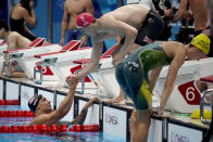 Caeleb Dressel, of the United States, left, talks with Britain's James Guy after the mixed 4x100-meter medley relay at the 2020 Summer Olympics, Saturday, July 31, 2021, in Tokyo, Japan. (AP Photo/David Goldman)