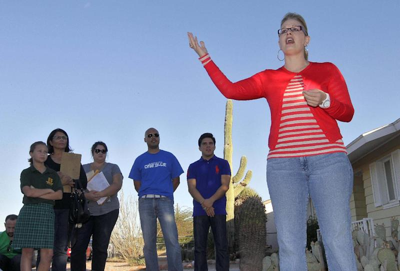 FILE - In a Monday, Nov. 5, 2012 file photo, former Democratic Arizona State Sen. and Arizona congressional candidate Kyrsten Sinema addresses residents in a neighborhood in Mesa, Ariz. Sinema has defeated Republican challenger Vernon Parker for Arizona's 9th Congressional District. (AP Photo/Matt York, File)