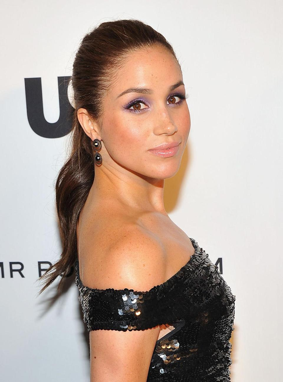"""<p>In 2012, Markle attended the USA Network and Mr Porter.com Present """"A Suits Story"""" with a neat slicked-back ponytail. (Photo: Theo Wargo/Getty Images for NBCUniversal/USA Network) </p>"""