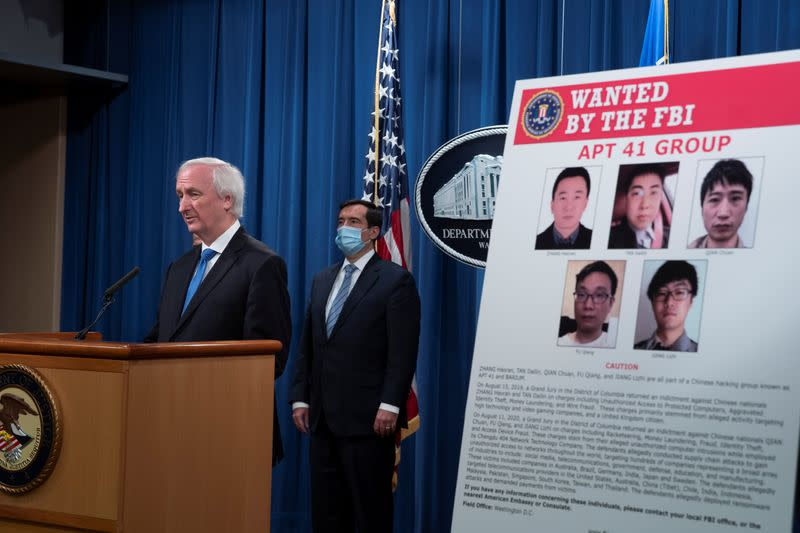 Justice Department's news conference to announce charges in China-related intrusion campaigns, in Washington