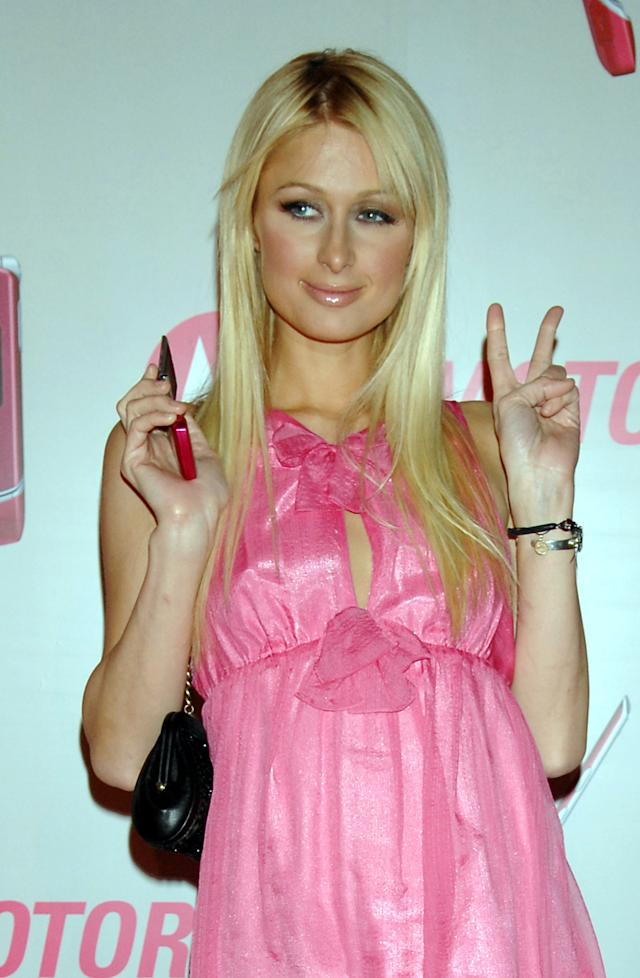 Paris Hilton at Launch of MOTORAZR in Japan, holding a hot pink model (Photo by Jun Sato/WireImage for MOTOROLA)