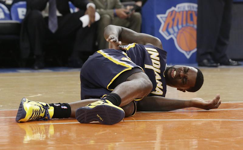 Indiana Pacers' Lance Stephenson lies on the court in the first half of Game 5 of an Eastern Conference semifinal in the NBA basketball playoffs against the New York Knicks, at Madison Square Garden in New York, Thursday, May 16, 2013. (AP Photo/Julio Cortez)